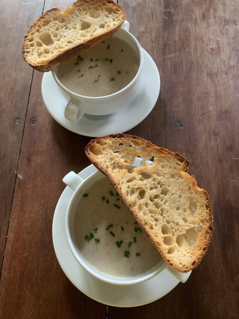 mushroom soup served with bread
