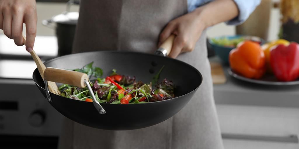 frying vegetables in a wok