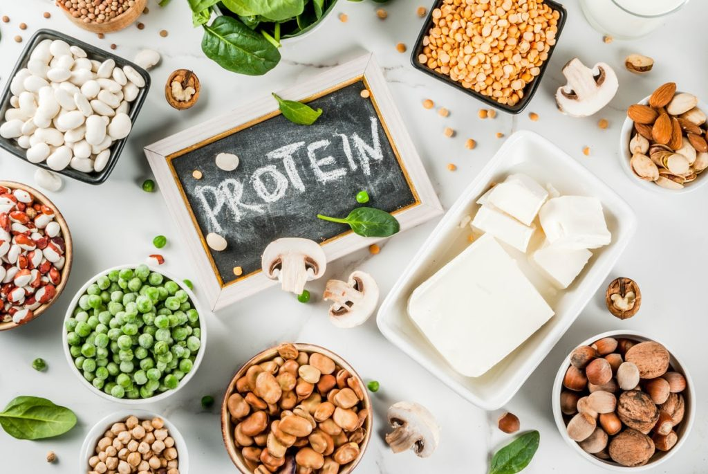 protein board surrounded by grains